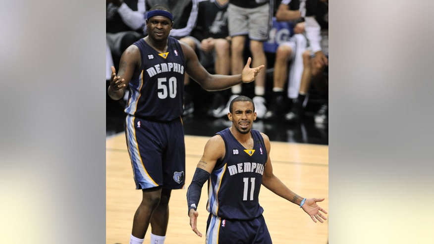 Memphis Grizzlies' Mike Conley (11) and Zach Randolph react to a call during the second half of Game 1 of the Western Conference final NBA basketball playoff series against the San Antonio Spurs, Sunday, May 19, 2013, in San Antonio. San Antonio won 105-83. (AP Photo/Darren Abate)