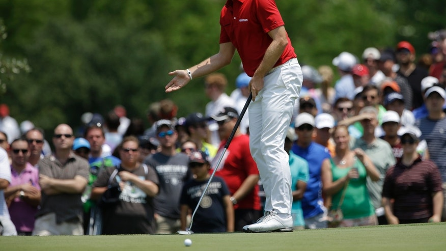 Keegan Bradley gestures as he watches his putt break on the second green during the final round of the Byron Nelson golf tournament Sunday, May 19, 2013, in Irving, Texas. (AP Photo/Tony Gutierrez)