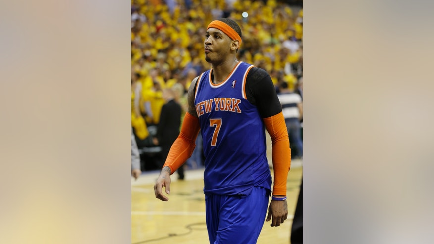 New York Knicks' Carmelo Anthony walks offcourt after the Indiana Pacers defeated New York 106-99 in Game 6 of an Eastern Conference semifinal NBA basketball playoff series on Saturday, May 18, 2013, in Indianapolis. Indiana won the series 4-2. (AP Photo/Darron Cummings)
