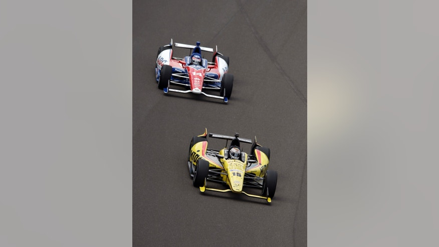 Takuma Sato, of Japan, top, follows Graham Rahal into the first turn during a practice session on the second day of qualifications for the Indianapolis 500 auto race at the Indianapolis Motor Speedway in Indianapolis, Sunday, May 19, 2013. (AP Photo/Darron Cummings)