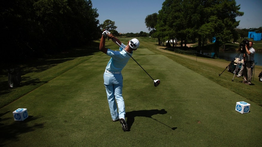 In this photo taken Tuesday, May 14, 2013, Guan Tianlang, 14, from China, tees off on the 15th hole during a practice round at Byron Nelson Championship golf tournament in Irving, Texas. (AP Photo/The Dallas Morning News, Brad Loper)  MANDATORY CREDIT; MAGS OUT; TV OUT; INTERNET USE AP MEMBERS ONLY; NO SALES.