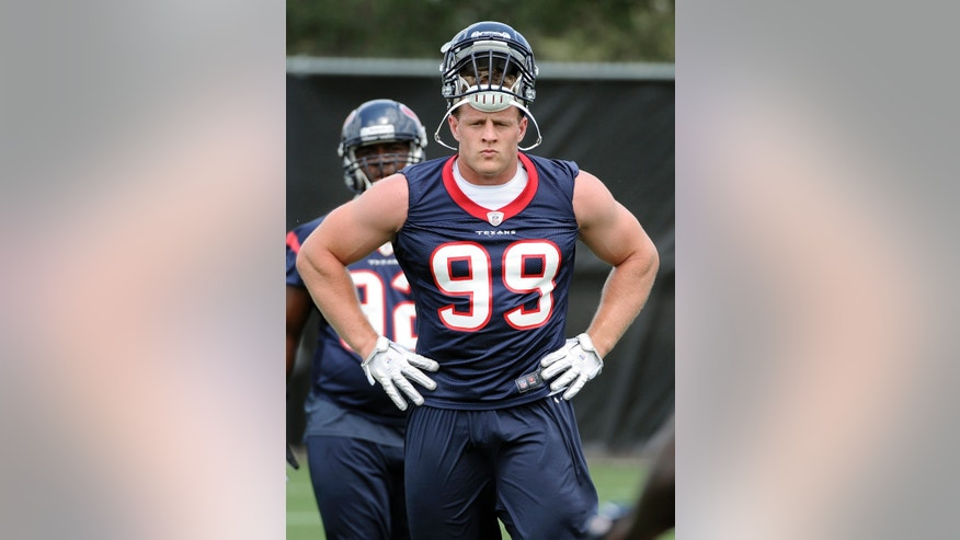 Houston Texans defensive end J.J. Watt (99) watches during directions during the NFL football team's workouts Monday, May 20, 2013, in Houston. (AP Photo/Pat Sullivan)