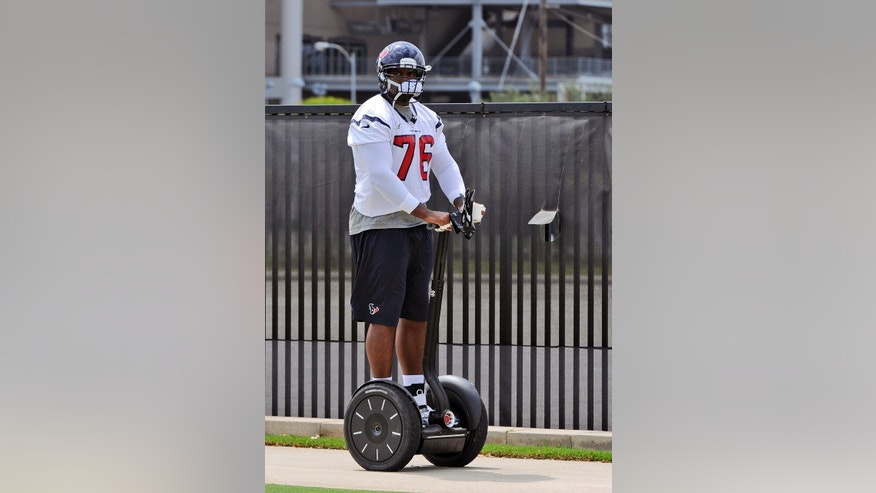 Houston Texans' Duane Brown arrives to the practice fields for the NFL football team's workouts Monday, May 20, 2013, in Houston. (AP Photo/Pat Sullivan)