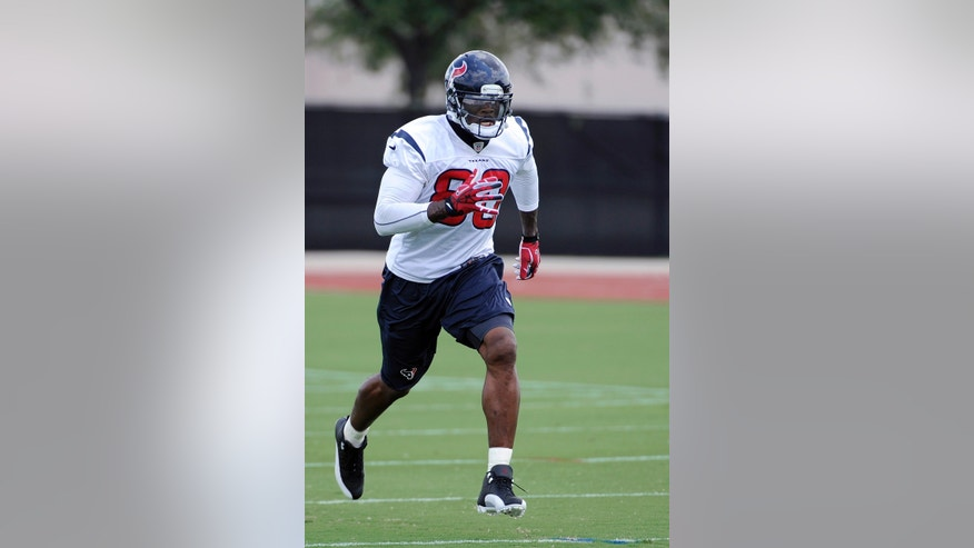 Houston Texans wide receiver Andre Johnson runs during the NFL football team's workouts Monday, May 20, 2013, in Houston. (AP Photo/Pat Sullivan)