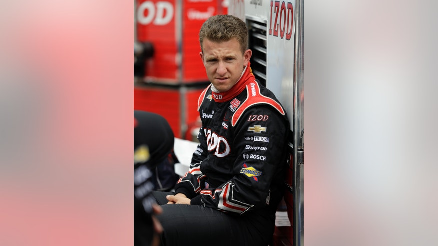 AJ Allmendinger sits on the pit wall as he waits for the start of practice for the Indianapolis 500 auto race at the Indianapolis Motor Speedway in Indianapolis, Friday, May 17, 2013. (AP Photo/Darron Cummings))