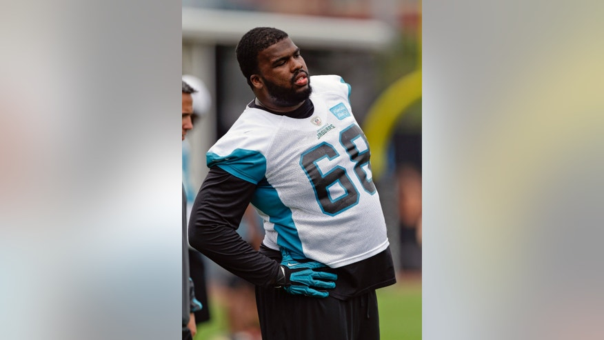 Jacksonville Jaguars defensive end Brandon Deaderick (68) stretches during NFL football organized training activities, Monday, May 20, 2013, in Jacksonville, Fla. (AP Photo/John Raoux)