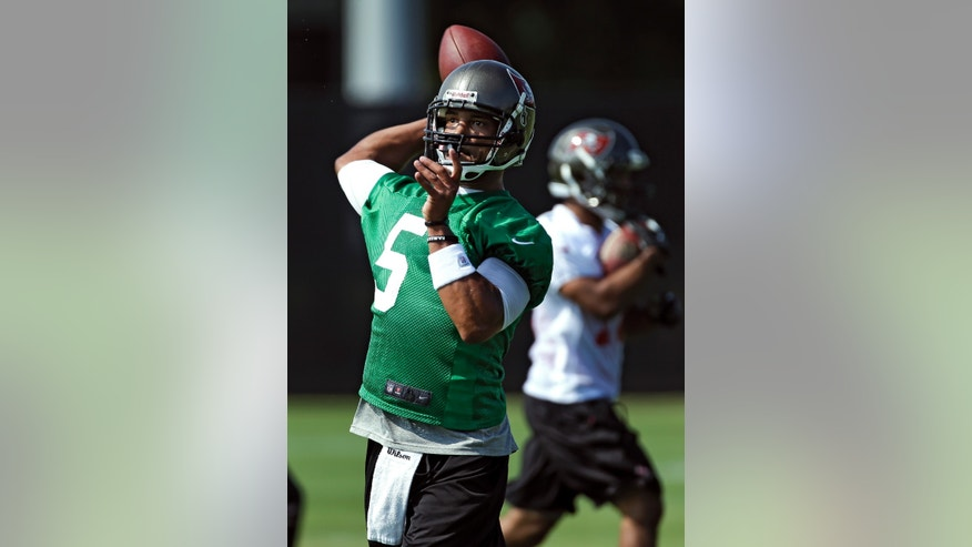Tampa Bay Buccaneers quarterback Josh Freeman throws a pass during an optional NFL football workout Monday, May 20, 2013, in Tampa, Fla. (AP Photo/Chris O'Meara)