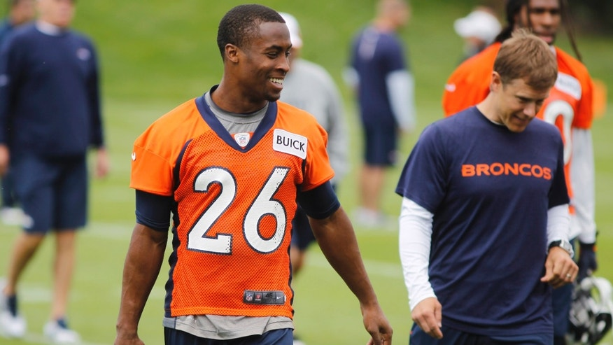 Denver Broncos free safety Rahim Moore jokes with teammates after an off=season training camp at the NFL football team's training facility in Englewood, Colo., on Monday, May 20, 2013. (AP Photo/David Zalubowski)