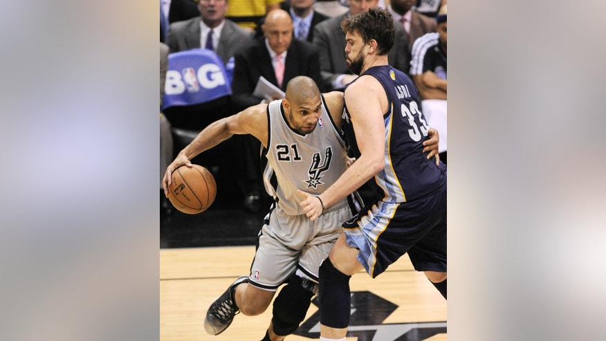 San Antonio Spurs' Tim Duncan, left, drives around Memphis Grizzlies' Marc Gasol, of Spain, during the second half of Game 1 of the Western Conference final NBA basketball playoff series Sunday, May 19, 2013, in San Antonio. (AP Photo/Darren Abate)