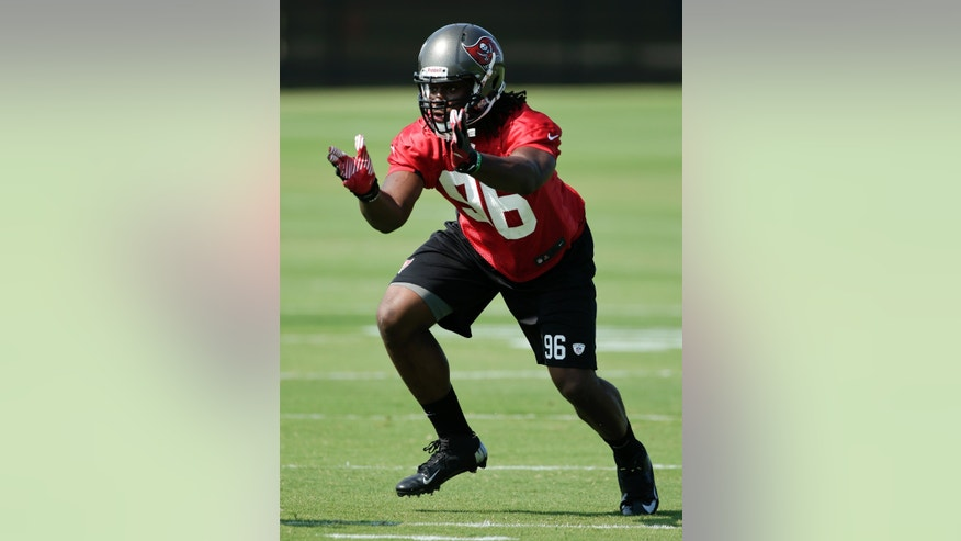 Tampa Bay Buccaneers defensive end Steven Means runs through a drill during an optional NFL football team workout Monday, May 20, 2013, in Tampa, Fla. (AP Photo/Chris O'Meara)