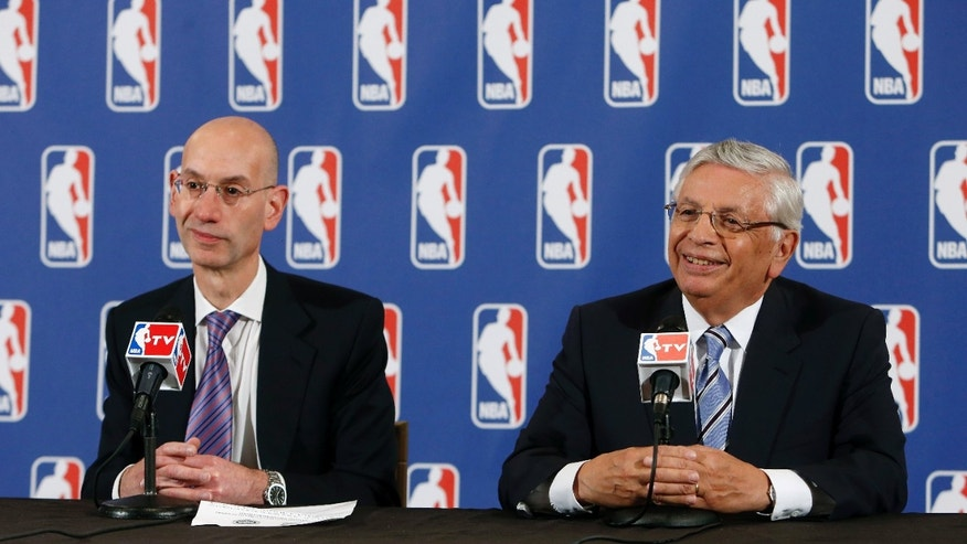 NBA Deputy Commissioner Adam Silver, left, and Commissioner David Stern attend a news conference before the NBA basketball draft lottery, Tuesday, May 21, 2013 in New York. (AP Photo/Jason DeCrow)