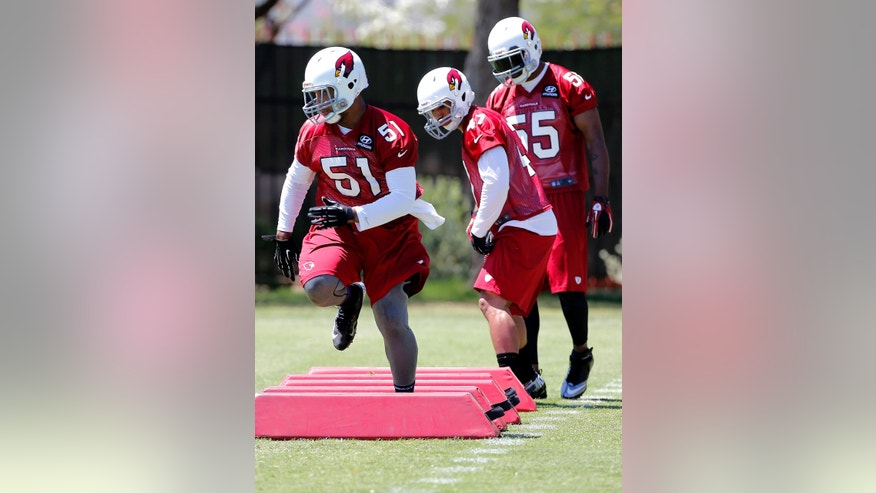 Arizona Cardinals' Kevin Minter (51) runs drills  during the team's NFL football organized team activities Tuesday, May 21, 2013, in Tempe, Ariz. (AP Photo/Matt York)