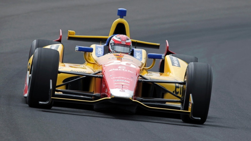 Carlos Munoz, of Colombia, drives through the first turn on his qualification run on the first day of qualifications for the Indianapolis 500 auto race at Indianapolis Motor Speedway in Indianapolis, Saturday, May 18, 2013. (AP Photo/AJ Mast)