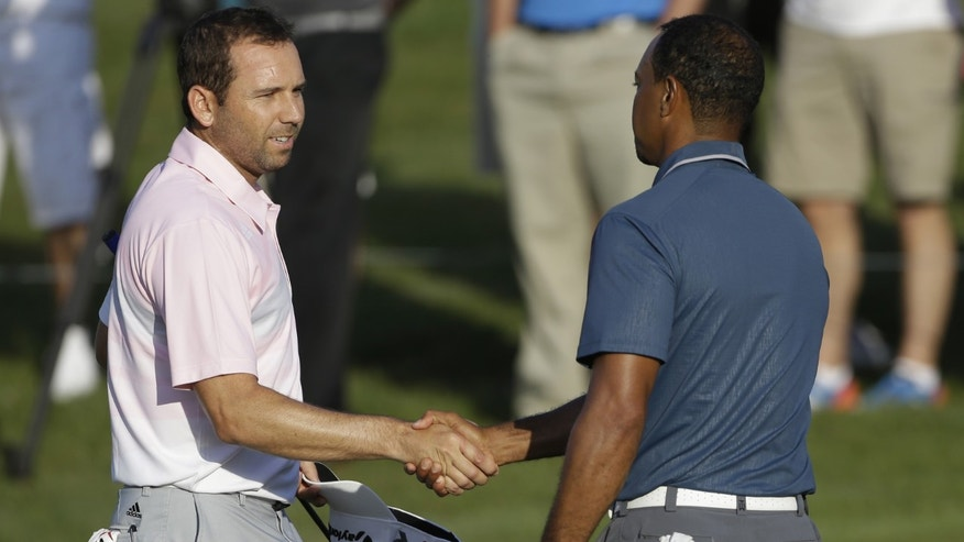 Sergio Garcia shakes hands with Tiger Woods at the conclusion of the third round of The Players championship, Sunday, May 12, 2013, in Ponte Vedra Beach, Fla.