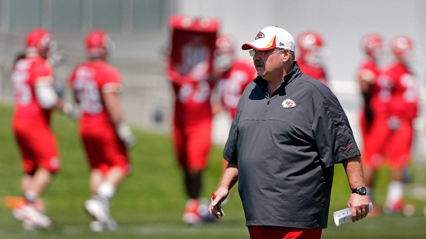 Kansas City Chiefs coach Andy Reid watches a drill during an NFL football training camp Wednesday, May 15, 2013, in Kansas City, Mo. (AP Photo/Charlie Riedel)