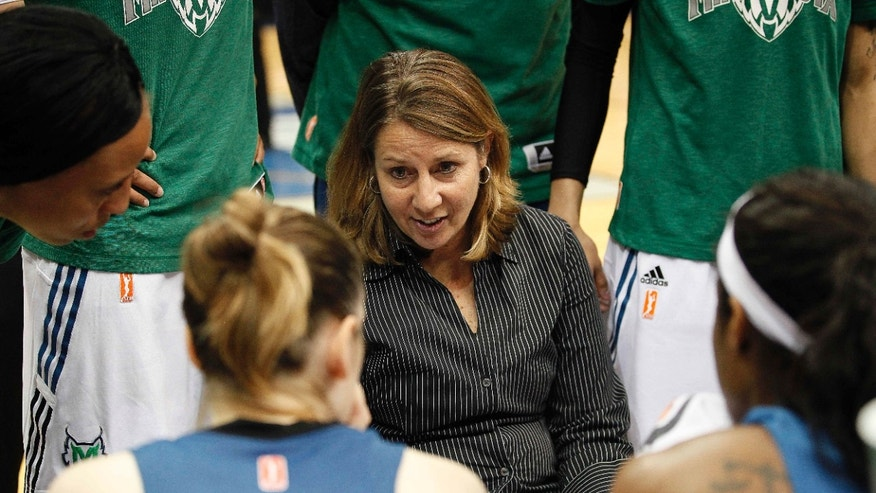 Minnesota Lynx head coach Cheryl Reeve talks with her team during a timeout against the Connecticut Sun in the second half of a WNBA preseason women's basketball game, Tuesday, May 21, 2013, in Minneapolis. The Sun won 80-88. (AP Photo/Stacy Bengs)