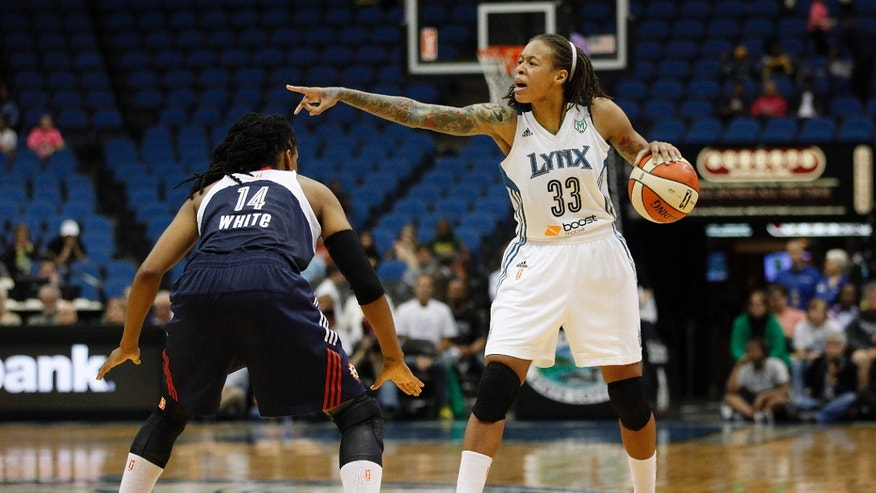 Minnesota Lynx guard Seimone Augustus (33) tries to set up a play against Connecticut Sun guard Tan White (14) in a WNBA preseason basketball game, Tuesday, May 21, 2013, in Minneapolis. (AP Photo/Stacy Bengs)