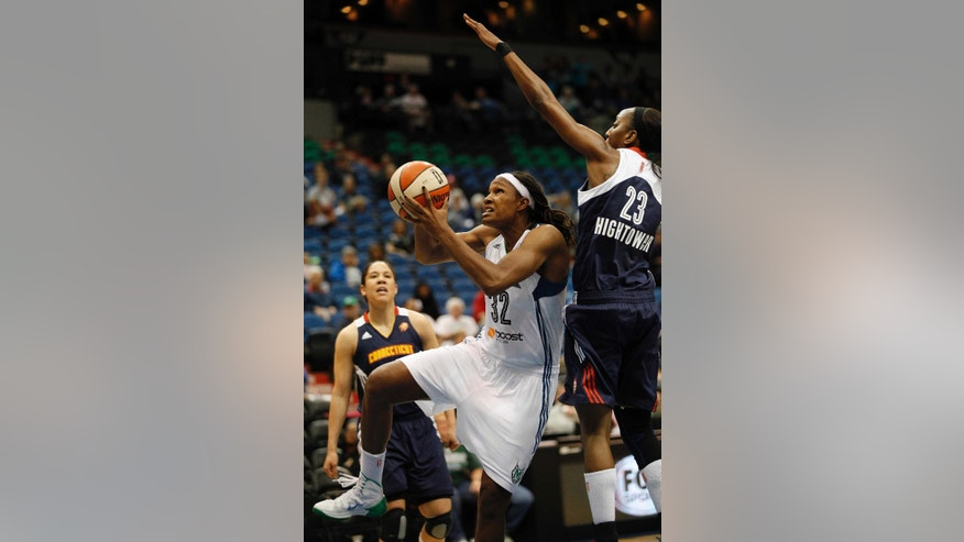 Minnesota Lynx forward Rebekkah Brunson (32) jumps up to the basket against Connecticut Sun guard Allison Hightower (23) in a WNBA preseason basketball game, Tuesday, May 21, 2013, in Minneapolis. (AP Photo/Stacy Bengs)