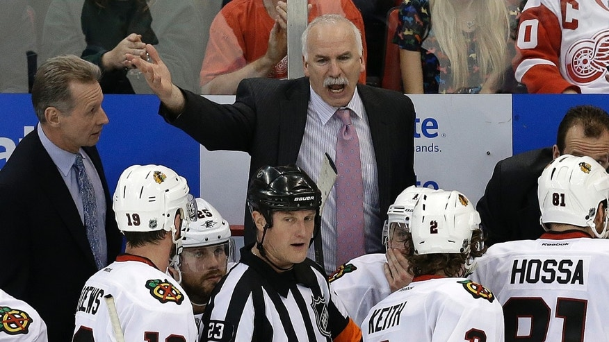 Chicago Blackhawks head coach Joel Quenneville yells at  referee Brad Watson (23) during the third period of an NHL hockey Stanley Cup playoffs Western Conference semifinal game in Detroit, Monday, May 20, 2013. (AP Photo/Paul Sancya)
