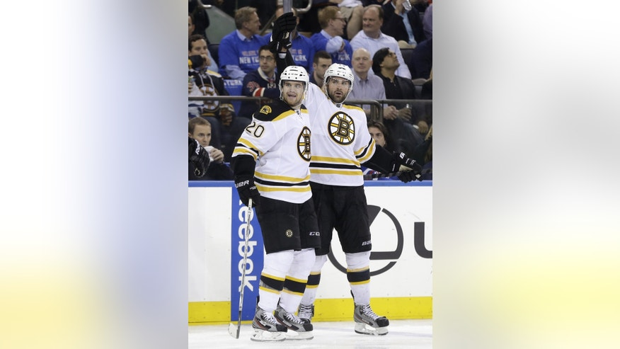 Boston Bruins' Johnny Boychuk, right, celebrates his goal with teammate Daniel Paille during the third period in Game 3 of the Eastern Conference semifinals in the NHL hockey Stanley Cup playoffs in New York Tuesday, May 21, 2013, in New York. Paille later scored the game-winner. The Bruins won 2-1 and lead the best-of-seven games series 3-0.(AP Photo/Seth Wenig)