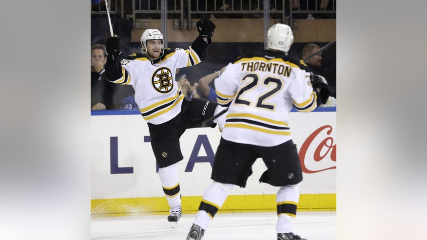 Boston Bruins' Daniel Paille, left, celebrates his game-winning goal with Shawn Thornton during the third period in Game 3 of the Eastern Conference semifinals in the NHL hockey Stanley Cup playoffs against the New York Rangers in New York Tuesday, May 21, 2013, in New York. The Bruins won 2-1 and lead the best-of-seven games series 3-0.  (AP Photo/Seth Wenig)