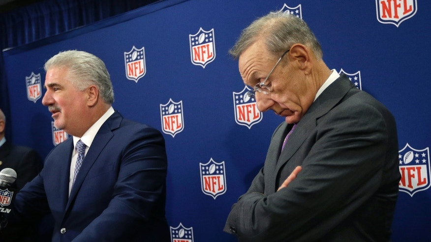 Miami Dolphins owner Stephen Ross, right, reacts as South Florida bid chairman Rodney Barreto speaks during a news conference at the NFL spring meetings in Boston, Tuesday, May 21, 2013, discussing their unsuccessful bids to host the NFL's Super Bowls in 2016 and 2017. (AP Photo/Elise Amendola)