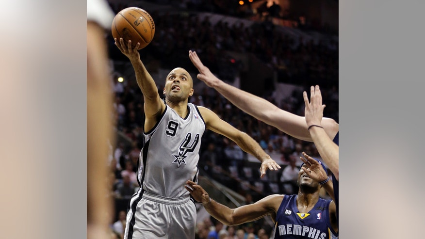 San Antonio Spurs' Tony Parker (9), of France, goes up for a shot against the Memphis Grizzlies defense during the first half in Game 2 of the Western Conference finals NBA basketball playoff series, Tuesday, May 21, 2013, in San Antonio. (AP Photo/Eric Gay)