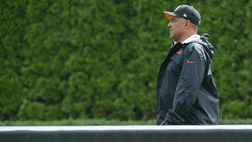 Cincinnati Bengals head coach Marvin Lewis walks past a blocking sled during an NFL football team practice Tuesday, May 21, 2013 at Paul Brown Stadium in Cincinnati, Ohio.  (AP Photo/Michael E. Keating)
