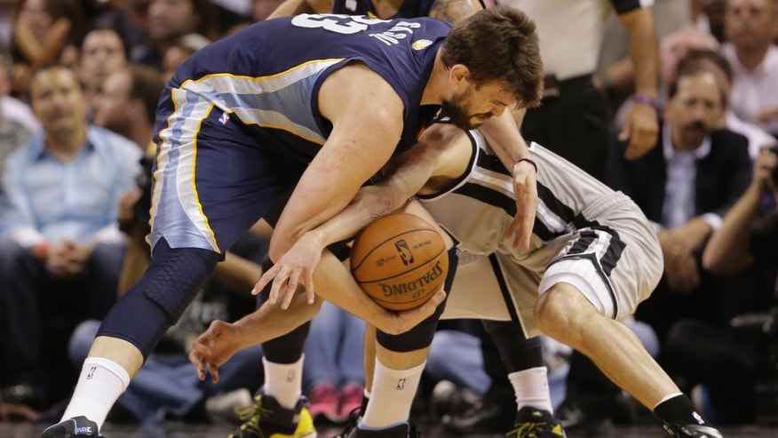 Memphis Grizzlies' Marc Gasol, left, and San Antonio Spurs' Manu Ginobili, of Argentina, during the first half in Game 2 of the Western Conference finals NBA basketball playoff series, May 21, 2013, in San Antonio.