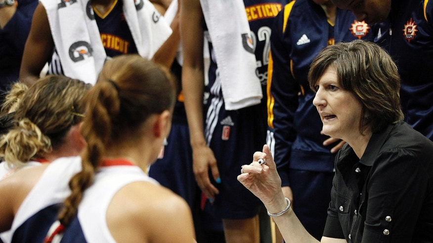 Connecticut Sun head coach Anne Donovan talks with her team during a timeout against the Minnesota Lynx in a WNBA preseason women's basketball game, Tuesday, May 21, 2013, in Minneapolis. The Sun won 88-80. (AP Photo/Stacy Bengs)