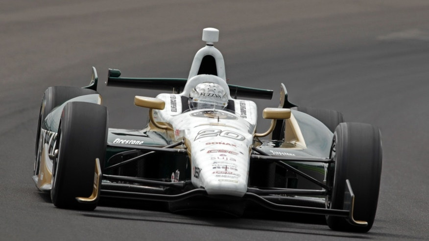 Ed Carpenter drives through the first turn on his qualification run on the first day of qualifications for the Indianapolis 500 auto race at Indianapolis Motor Speedway in Indianapolis, Saturday, May 18, 2013. (AP Photo/AJ Mast)