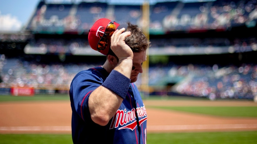 Minnesota Twins' Josh Willingham walks into the dugout after coming off the field before the team takes their last at bat in the ninth inning of a baseball game against the Atlanta Braves, Wednesday, May 22, 2013, in Atlanta. Atlanta won 8-3. (AP Photo/David Goldman)