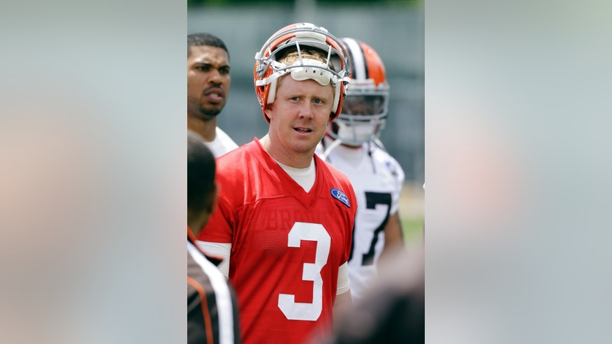 Cleveland Browns quarterback Brandon Weeden comes off the field after an off-season workout at the NFL football team's practice facility in Berea, Ohio Thursday, May 23, 2013. (AP Photo/Mark Duncan)