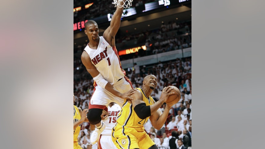 Miami Heat center Chris Bosh (1) pressures Indiana Pacers forward David West (21) during the first half of Game 1 in their NBA basketball Eastern Conference finals playoff series, Wednesday, May 22, 2013 in Miami. (AP Photo/Lynne Sladky)