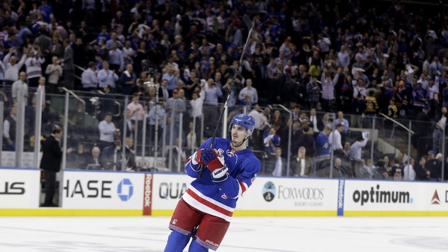 New York Rangers' Chris Kreider acknowledges the crowd after he scored the winning goal during the overtime period in Game 4 of the Eastern Conference semifinals in the NHL hockey Stanley Cup playoffs, Thursday, May 23, 2013, in New York. The Rangers won 4-3. (AP Photo/Seth Wenig)