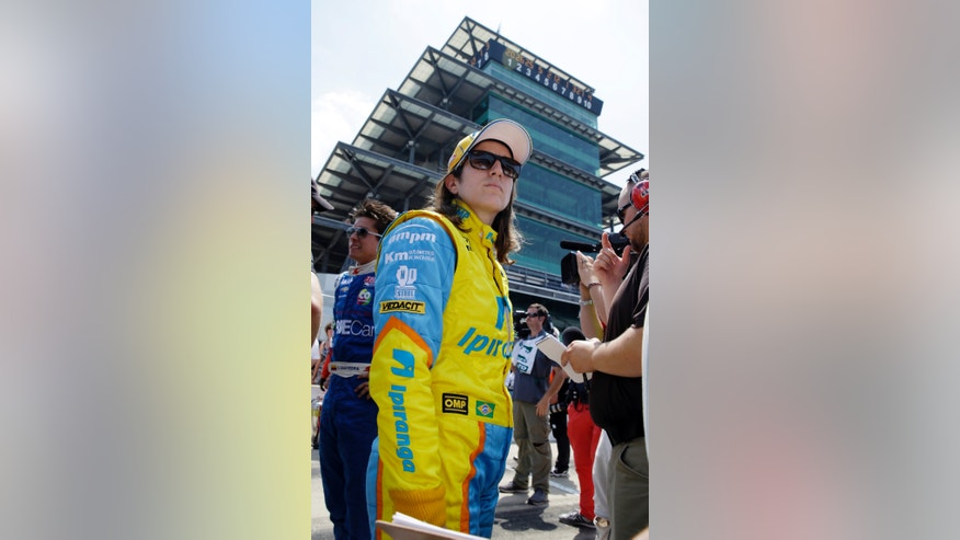 In this photo taken on Sunday, May 19, 2013, Ana Beatriz, of Brazil, stands in the pits after the second day of qualifications for the Indianapolis 500 auto race at the Indianapolis Motor Speedway in Indianapolis. Beatriz is one of four women starting Sunday's race. (AP Photo/Tom Strattman)