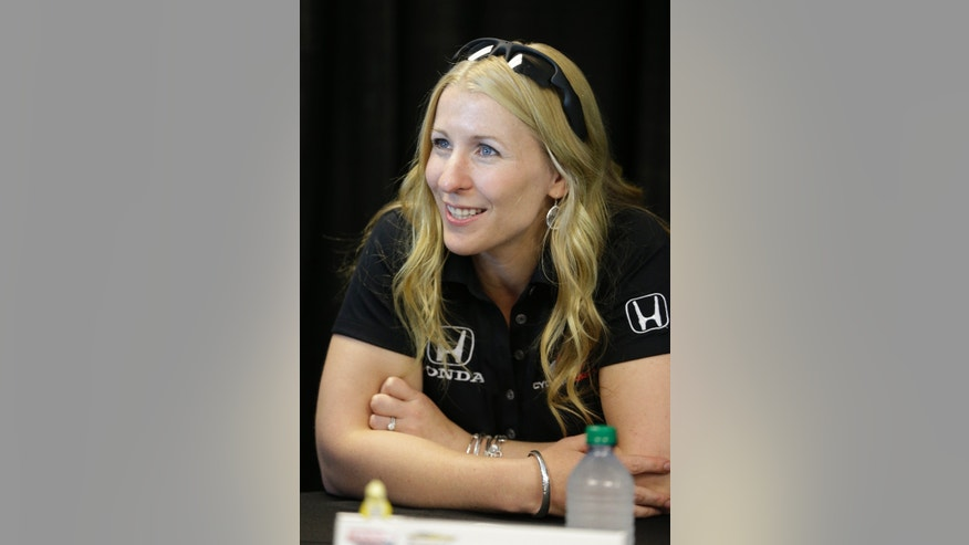Pippa Mann, of England, listens to a question during a media interview for the Indianapolis 500 auto race at the Indianapolis Motor Speedway in Indianapolis, Thursday, May 23, 2013. (AP Photo/Darron Cummings)