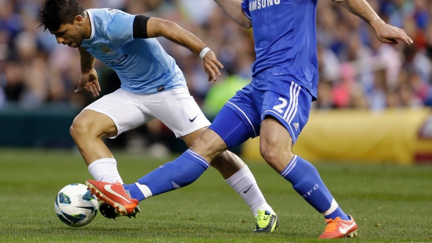 Manchester City's Sergio Aguero, left, of Argentina, is challenged by Chelsea's Branislav Ivanovic, right, of Serbia, during the first half of an exhibition soccer match on Thursday, May 23, 2013, at Busch Stadium in St. Louis. (AP Photo/Jeff Roberson)