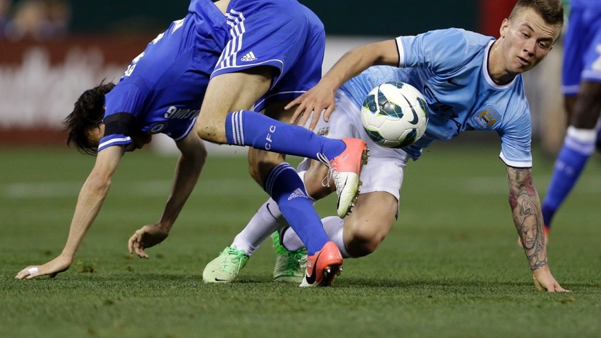 CORRECTS MANCHESTER CITY'S PLAYER TO ALBERT RUSNAK, NOT EMYR HUWS - Chelsea's Yossi Benayoun, left, and Manchester City's Albert Rusnak challenge for the ball during the first half of an exhibition soccer match, Thursday, May 23, 2013, at Busch Stadium in St. Louis. (AP Photo/Jeff Roberson)