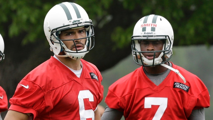 New York Jets quarterbacks Mark Sanchez (6) and Geno Smith (7) stand together during NFL football practice in Florham Park, N.J., Wednesday, May 22, 2013. (AP Photo/Mel Evans)