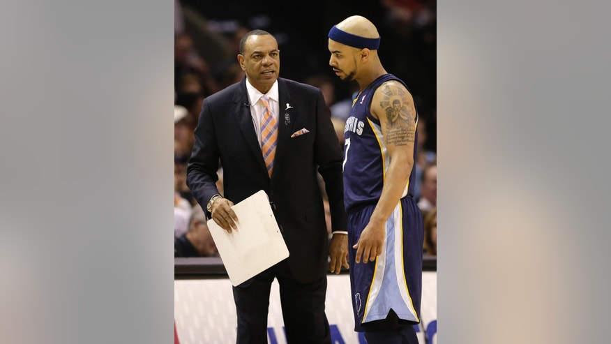 Memphis Grizzlies coach Lionel Hollins, left, talks to Jerryd Bayless during the first half in Game 2 of the Western Conference finals NBA basketball playoff series against the San Antonio Spurs, Tuesday, May 21, 2013, in San Antonio. (AP Photo/Eric Gay)