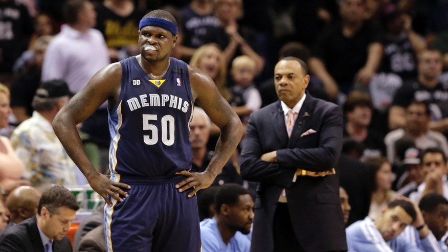 Memphis Grizzlies' Zach Randolph (50) and coach Lionel Hollins react along the sideline during the first half in Game 2 of the Western Conference finals NBA basketball playoff series against the San Antonio Spurs, Tuesday, May 21, 2013, in San Antonio. (AP Photo/Eric Gay)