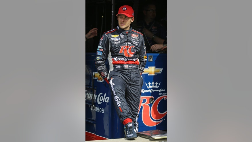 In this photo taken on Wednesday, May 15, 2013, Marco Andretti sits in his pit box during practice for the Indianapolis 500 auto race at the Indianapolis Motor Speedway in Indianapolis. Andretti went into the Indianapolis 500 last year believing the race was his to lose. Well, he lost and the Andretti Curse lives. Now off to his best start, he could become the first Andretti to win the showcase race since his grandfather in 1969. (AP Photo/Michael Conroy)