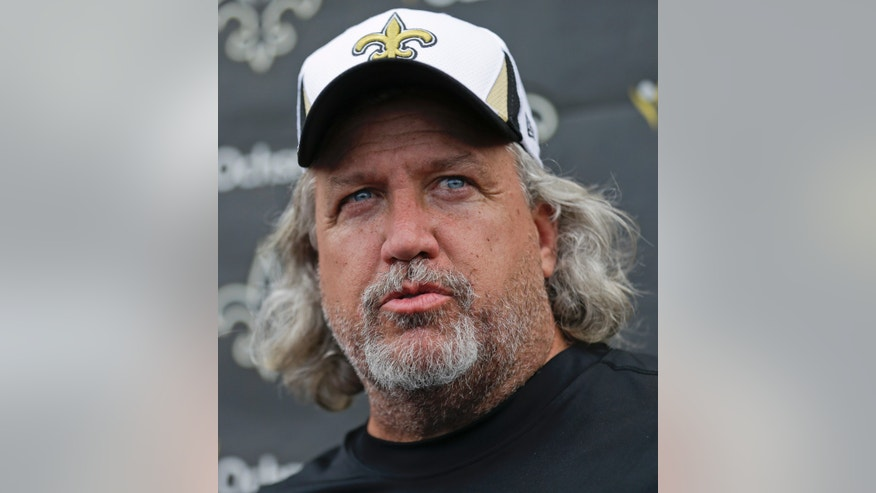 New Orleans Saints defensive coordinator Rob Ryan talks to reporters after practice at their NFL football training facility in Metairie, La., Thursday, May 23, 2013. (AP Photo/Gerald Herbert)