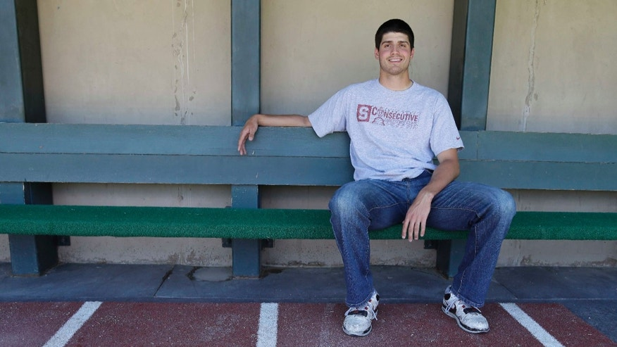 In this photo taken Monday May 20, 2013, Stanford pitcher Mark Appel poses in the dugout of the Sunken Diamond in Stanford, Calif. As Appel sat in the Stanford dugout and glanced out at the field this week, the star pitcher reminded himself just how much it meant to return for his final college season. Unpopular choice for some, the right one for a projected high first-round draft pick once again a year after he turned down the Pittsburgh Pirates as the eighth overall choice to go back to school. (AP Photo/Eric Risberg)