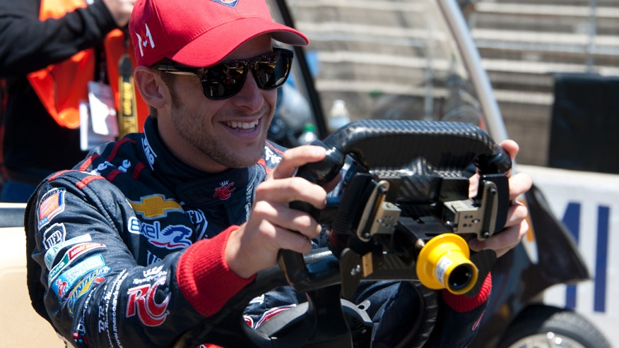 IndyCar Marco Andretti checks out his steering wheel during the Pit Stop Challenge on Carb Day at the Indianapolis Motor Speedway, Friday, May 24, 2013, in Indianapolis. (AP Photo/The Indianapolis Star, Jessica Hoffman) NO SALES.