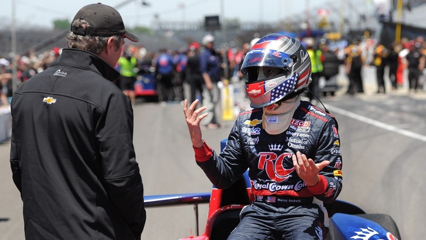 IndyCar driver Marco Andretti throws his hands up after stalling out twice during the pit stop competition on Carb Day at the Indianapolis Motor Speedway on Friday, May 24, 2013. (AP Photo/The Indianapolis Star, Matt Detrich) NO SALES.