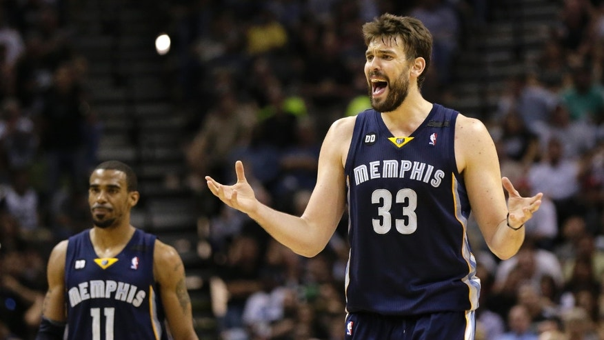 Memphis Grizzlies' Marc Gasol (33) reacts to a call during the second half in Game 2 of the Western Conference finals NBA basketball playoff series against the San Antonio Spurs, Tuesday, May 21, 2013, in San Antonio. At left is Memphis Grizzlies' Mike Conley. (AP Photo/Eric Gay)