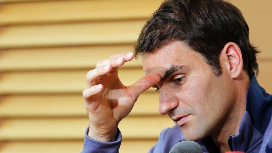 Roger Federer of Switzerland gestures during a press conference for the 2013 French Open tennis tournament, at Roland Garros stadium in Paris, Friday May, 24, 2013. (AP Photo/Christophe Ena)