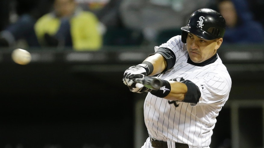 Chicago White Sox's Hector Gimenez hits an one-run single during the fifth inning of an interleague baseball game against the Miami Marlins, Friday, May 24, 2013, in Chicago. (AP Photo/Nam Y. Huh)